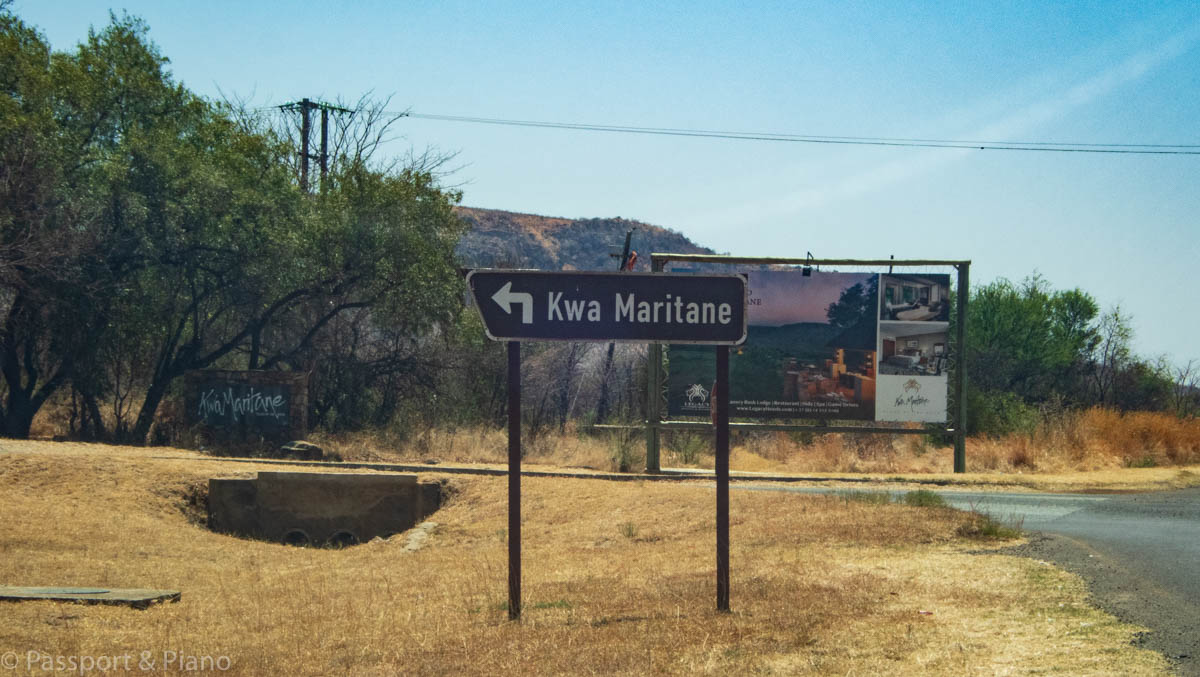 An image of the sign for Pilanesberg Kwa-Maritane entrance gate from the main road.